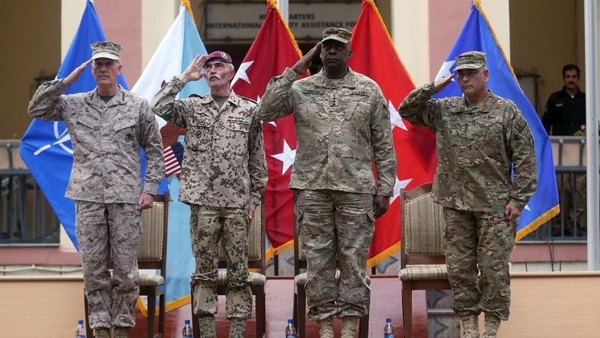 Aug. 26, 2014: Outgoing commander of ISAF, U.S. Gen. Joseph Dunford, first left, and incoming U.S. Army Commander for International Security Assistance Forces (ISAF), Gen. John F. Campbell, first right, salute during a change of command ceremony at the ISAF Headquarters in Kabul, Afghanistan. (AP)
