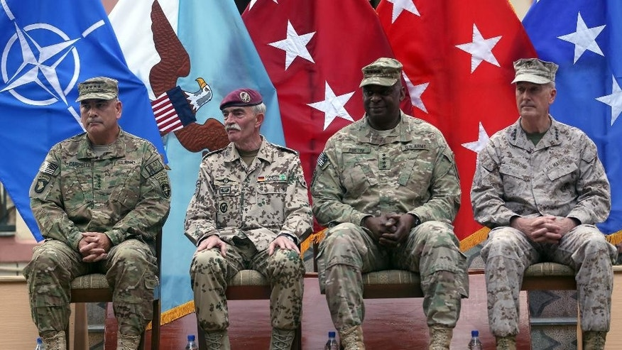 Aug. 26, 2014: Outgoing commander of ISAF, U.S. Gen. Joseph Dunford, first right, and incoming U.S. Army Commander for International Security Assistance Forces (ISAF), Gen. John F. Campbell, first left, sit after the change of command ceremony at the ISAF Headquarters in Kabul, Afghanistan. (AP)