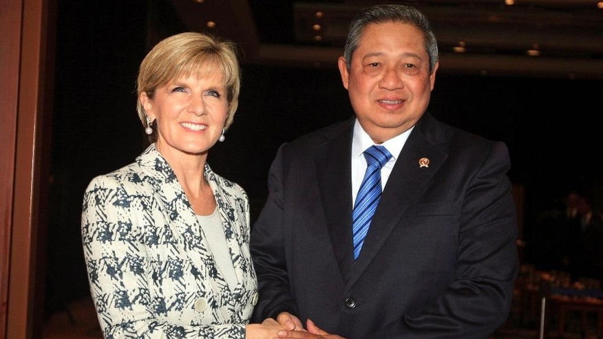 Indonesia's President Susilo Bambang Yudhoyono, right, greets Australia's Foreign Minister Julie Bishop during a meeting in Bali, Indonesia, Thursday, Aug. 28, 2014.  Australia and Indonesia have reached a new agreement on how they'll use their intelligence operations in the future, even settling their disagreement on its name. The agreement their foreign ministers are scheduled to sign Thursday on the Indonesian resort island of Bali is designed to mend a rift sparked last November by accusations that Australians tapped the cellphones of the Indonesian president, his wife and eight ministers and officials in 2009. (AP Photo/Firdia Lisnawati)