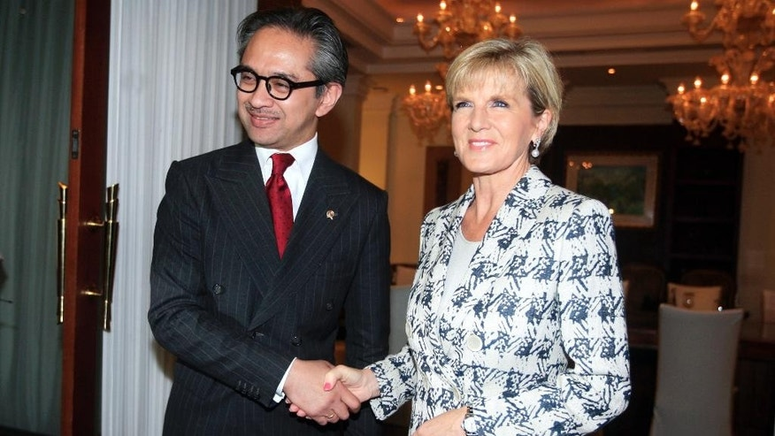 Indonesia's Foreign Minister Marty Natalegawa, left, shakes hands with his Australia counterpart Julie Bishop during their bilateral meeting in Bali, Indonesia, Thursday, Aug. 28, 2014.  Australia and Indonesia have reached a new agreement on how they'll use their intelligence operations in the future, even settling their disagreement on its name. The agreement their foreign ministers are scheduled to sign Thursday on the Indonesian resort island of Bali is designed to mend a rift sparked last November by accusations that Australians tapped the cellphones of the Indonesian president, his wife and eight ministers and officials in 2009.(AP Photo/Firdia Lisnawati)