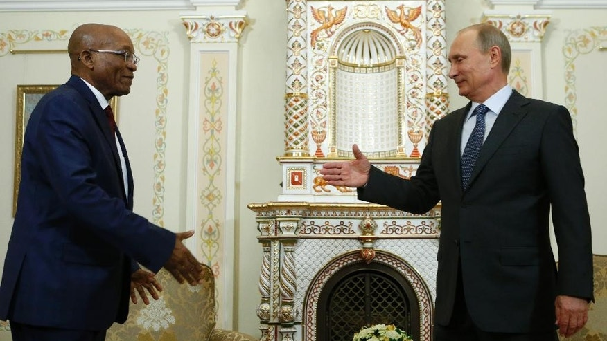 Russia's President Vladimir Putin, right, greets his South African counterpart Jacob Zuma during their meeting at the Novo-Ogaryovo state residence outside Moscow, Thursday, Aug. 28, 2014. (AP Photo/Sergei Karpukhin, pool)