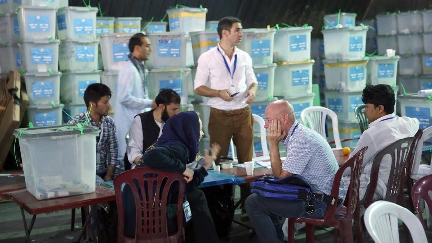 Aug. 27, 2014: Afghan election commission workers sort ballots for an audit of the presidential run-off votes in front of international observers at an election commission office in Kabul, Afghanistan.  (AP)