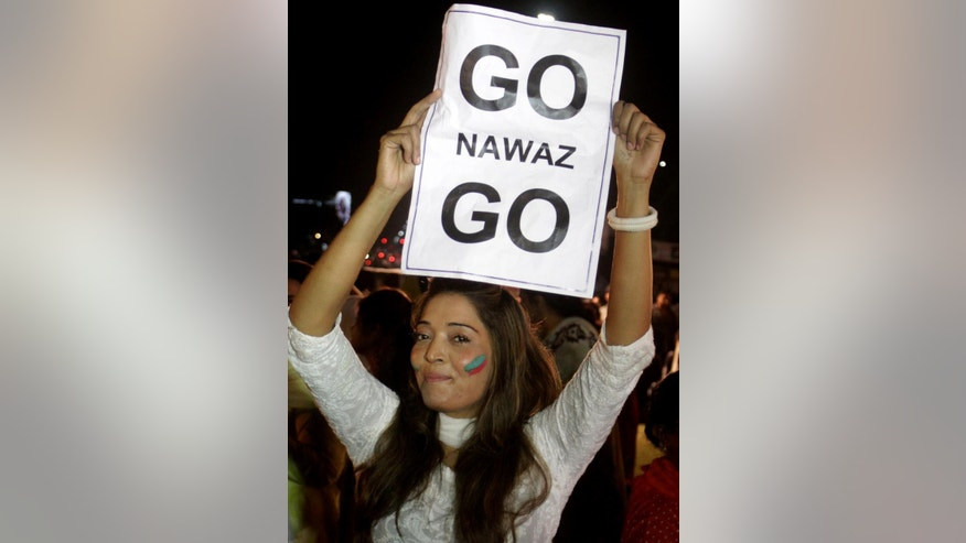 A supporter of Pakistan's cricket celebrity-turned-politician Imran Khan rally against government in Lahore, Pakistan, Thursday, Aug. 28, 2014.  Pakistani police have registered allegations of abetting murder against Prime Minister Nawaz Sharif and his brother over the June killing of 14 supporters of a cleric who is currently leading thousands of anti-government demonstrators in Islamabad. (AP Photo/K.M. Chaudary)