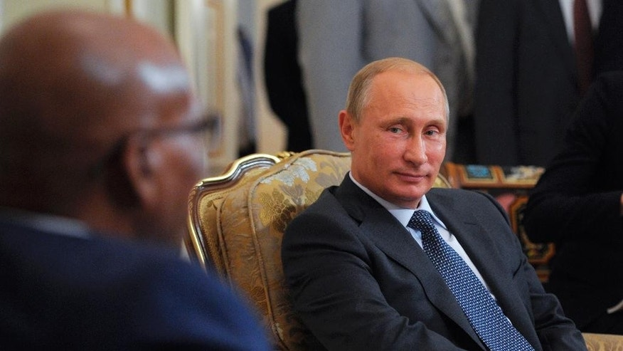 Russian President Vladimir Putin, right, meets with South African President Jacob Zuma in the Novo-Ogaryovo residence outside Moscow, Russia, Thursday, Aug. 28, 2014. (AP Photo/RIA-Novosti, Alexei Druzhinin, Presidential Press Service)