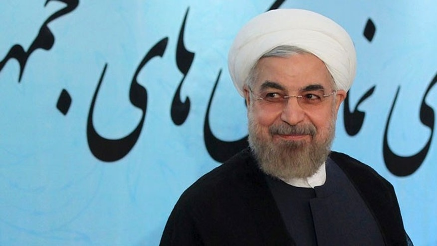Aug. 11, 2014: Iran's President Hassan Rouhani smiles while attending an annual meeting of Iranian ambassadors in Tehran, Iran.