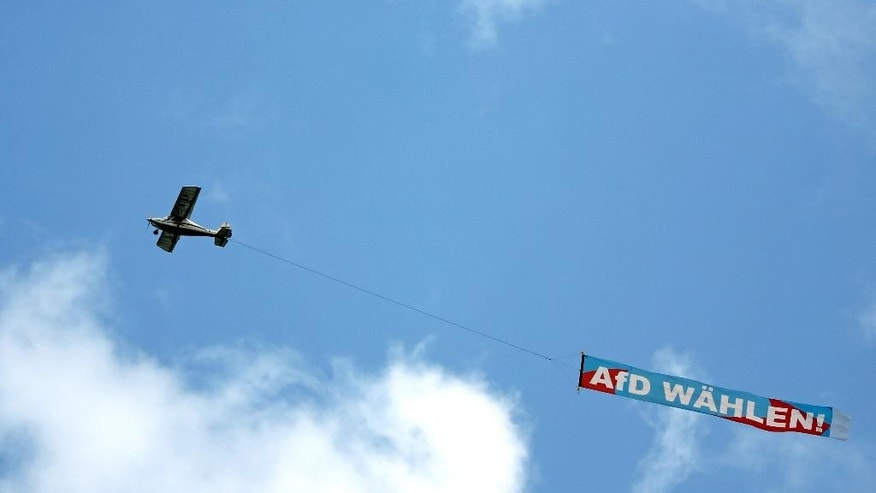 In this Aug. 21, 2014 file picture a small plane carries  a banner during an election campaign of the German 'Alternative fuer Deutschland'  AfD party in Grimma, Saxony State, Germany. The  party that wants Germany to ditch the euro currency is tipped to win its first seat in a state assembly Sunday Aug. 31, 2014. A recent poll conducted for public broadcaster ZDF predicts that the party Alternative for Germany will receive seven percent of the vote in elections for the Saxony state parliament. This would be enough for the party, which was founded only last year, to clear the five-percent hurdle needed to enter parliament Banner reads : Vote AfD. (AP Photo/dpa,Jan Woitas,file)