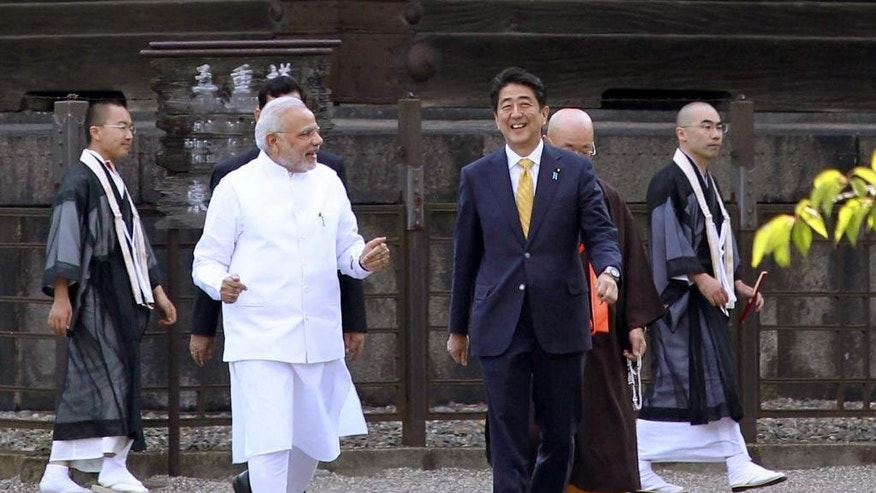 Indian Prime Minister Narendra Modi, front left, and his Japanese counterpart Shinzo Abe, front right, stroll at Toji Temple in Kyoto, western Japan Sunday, Aug. 31, 2014.  (AP Photo/Japan Pool via Kyodo News) JAPAN OUT, MANDATORY CREDIT