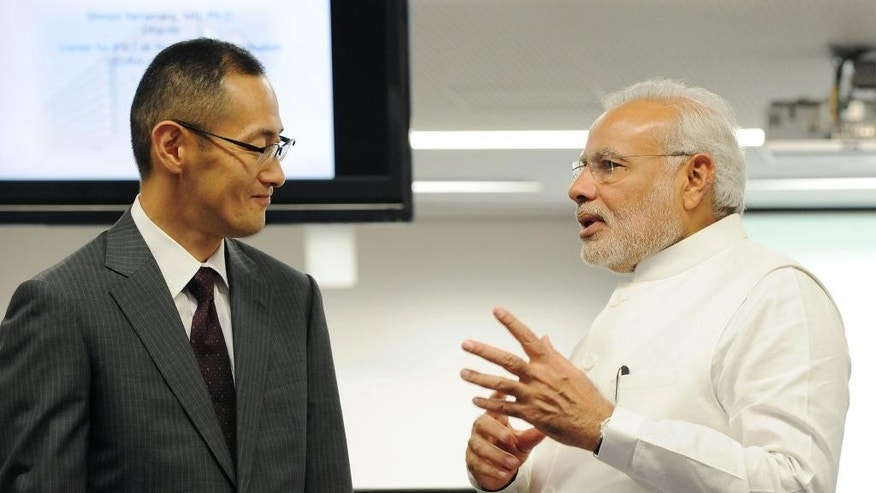 Indian Prime Minister Narendra Modi, left, and iPS cell researcher and Nobel Prize laureate, Shinya Yamanaka, chat during Modi's visit at Kyoto Universaity in Kyoto, western Japan Sunday, Aug. 31, 2014.  (AP Photo/Kyodo News) JAPAN OUT