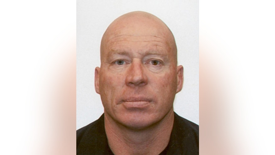 In this undated photo provided by New Zealand Police, John Henry Tully, 48, poses for a photo. A manhunt for Tully is underway Monday, Sept. 1, 2014, after police said a gunman killed two people and injured a third at an unemployment office before escaping on a bicycle in Ashburton, New Zealand. According to police, a man entered a Work and Income New Zealand office and started shooting. (AP Photo/New Zealand Police)