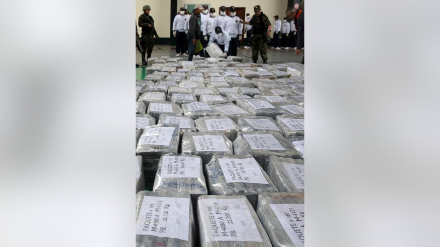 "ADDS THE WORD ""METRIC"" TO TONS AND THE TONS EQUIVALENT - Blocks of seized cocaine are presented to the press at a police base in Lima, Peru, Monday, Sept. 1, 2014. According to police, the packages are part of a 7.7 metric tons (8.5 tons) cocaine seizure made in the northern town of Trujillo on Aug. 26, and is the largest cocaine seizure in Peru's history. (AP Photo/Martin Mejia)"