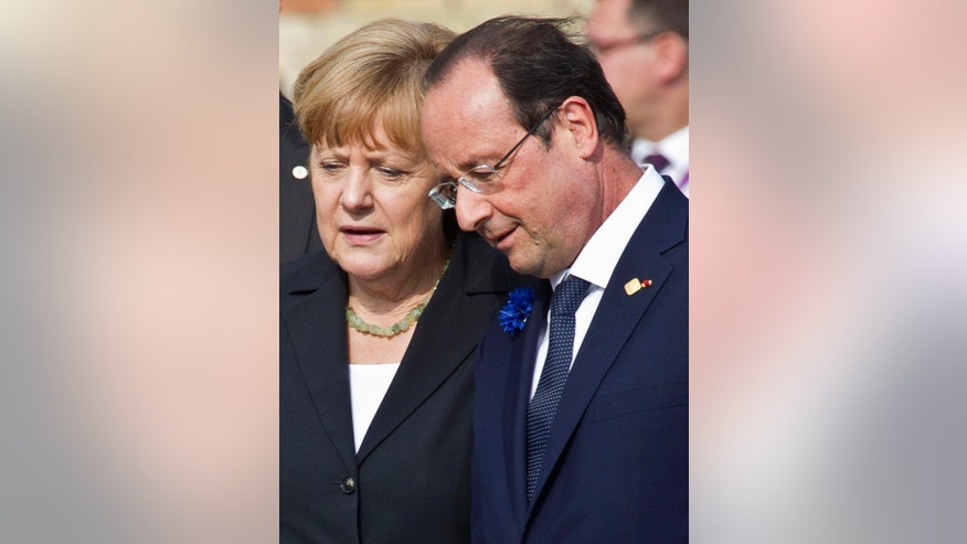 FILE - This is a  Thursday, June 26, 2014  file photo of  German Chancellor Angela Merkel, left, as she speaks with French President Francois Hollande as they walk in the town square during an EU Summit in Ypres, Belgium .  For more than five years since the eurozone hit turbulence over too much debt in 2009, their answer has been to tighten the lap belts of austerity: more taxes, restrained spending, smaller deficits. And there's been some progress. Deficits have shrunk, and countries that needed bailout loans are slowly getting their act together. (AP Photo/Michel Euler, File)