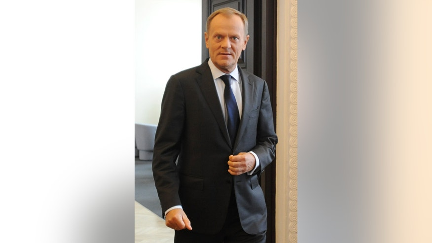 Polish Prime Minister Donald Tusk  arrives for a  a government meeting in Warsaw, Poland, Tuesday, Sept. 2, 2014. Tusk was chosen by European leaders to be the next president of the European Council.   (AP Photo/Alik Keplicz)