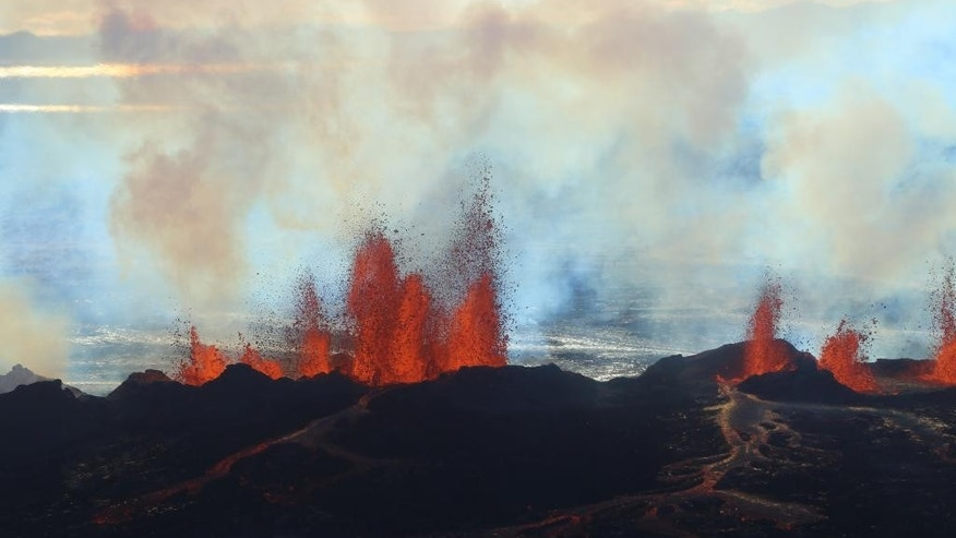 In this aerial view, fountains of lava, up to 60 meters high, spurt from a fissure in the ground on the north side of the Bardarbunga volcano in Iceland, Tuesday, Sept. 2, 2014. The alert warning for the area surrounding Iceland's Bardarbunga volcano remained at orange on Tuesday, indicating that it is showing increased unrest with greater potential for an explosive eruption. (AP Photo/Stefano Di Nicolo)