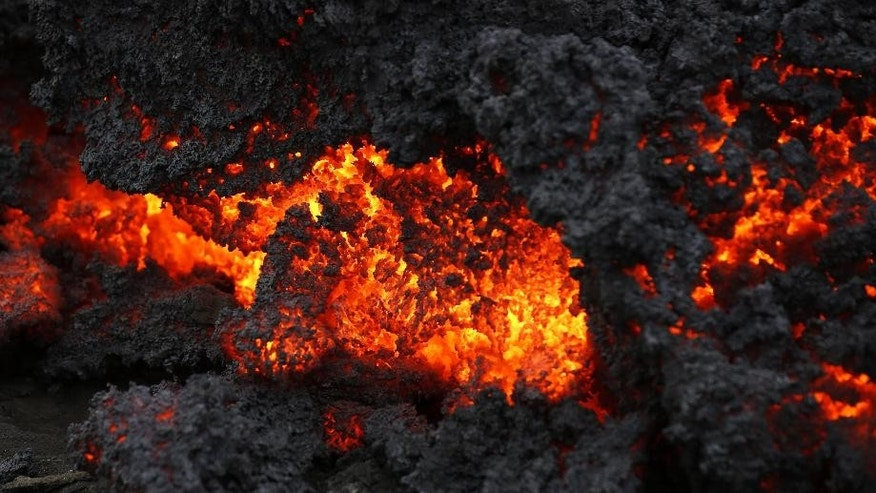 A close up of lava from an eruption on Holuhraun, northwest of the Dyngjujoekull glacier in Iceland, Monday, Sept. 1, 2014.  Lava fountains danced along a lengthy volcanic fissure near Iceland's subglacial Bardarbunga volcano Sunday, prompting authorities to raise the aviation warning code to the highest level and close the surrounding airspace. The warning was lowered 12 hours later as visibility improved and it was clear that no volcanic ash was detected. (AP Photo/Eggert Johannesson)