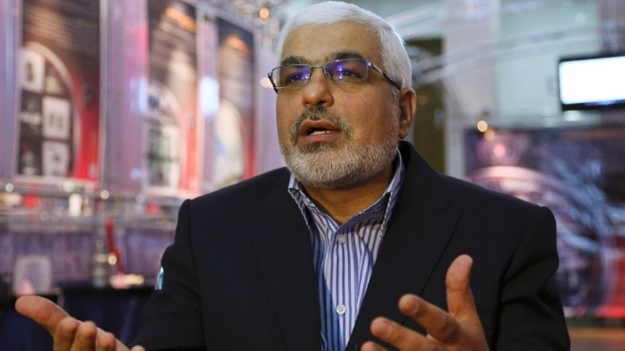 Sept. 1, 2014: Deputy head of the Atomic Energy Organization of Iran Asghar Zarean speaks in an interview with Associated Press as he is seated in a display of various parts and equipment from valves and pumps to electro motors, modems and barometers that they say were exported to the country with alleged purpose of sabotage and spying on Irans nuclear facilities in Tehran, Iran. (AP/Vahid Salemi)