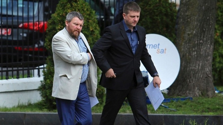 September 1, 2014: Pro-Russian rebel leaders from Eastern Ukraine Andrei Purgin, left, and Alexey Karyakin  walk in Minsk, Belarus. (AP Photo/Dmitry Brushko)