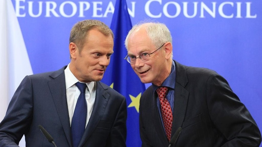 FILE- In this Sept.12, 2011 file photo then  European Council President Herman Van Rompuy, right, and Poland's Prime Minister Donald Tusk address the media, at the European Council building in Brussels. Tusk was chosen by European leaders to be the next president of the European Council.  (AP Photo/Yves Logghe)