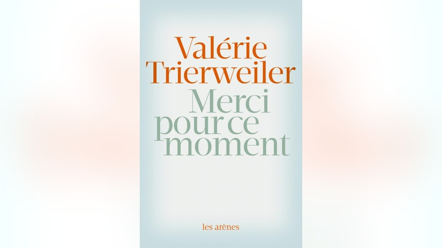 "This photo provided Wednesday Sept. 3, 2014 by the publisher Les Arenes shows the front page of Valerie Trierweiler's book ""Merci pour ce moment"" (Thanks for this moment). Former French first lady Valerie Trierweiler's book relates her life at the presidential palace under French President Francois Hollande and will go on sale Thursday.(AP Photo/Editions Les Arenes)"