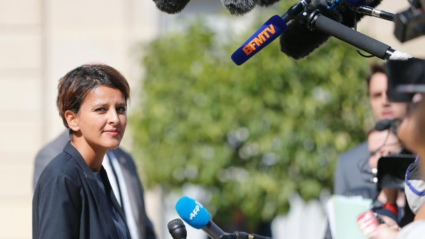 French Education Minister Najat Vallaud-Belkacem speaks to members of the media after the weekly cabinet meeting at the Elysee Palace, in Paris, France, Wednesday, Sept. 3, 2014. (AP Photo/Jacques Brinon)