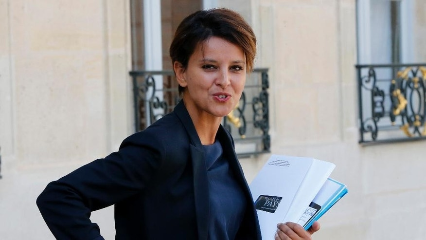 French Education Minister Najat Vallaud-Belkacem smiles as she departs after the weekly cabinet meeting at the Elysee Palace, in Paris, France, Wednesday, Sept. 3, 2014. (AP Photo/Jacques Brinon)