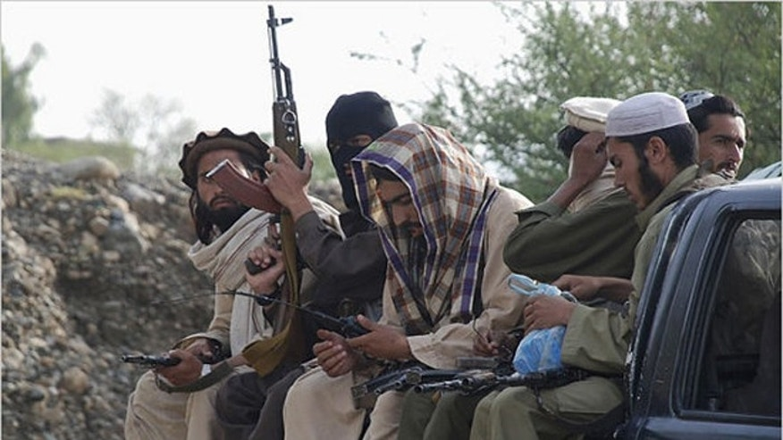 Taliban fighters in South Waziristan, shown here in file photo, face bombardment from U.S. drones and the Pakistani government. Many are going to Syria to fight with Islamic State. (Reuters)