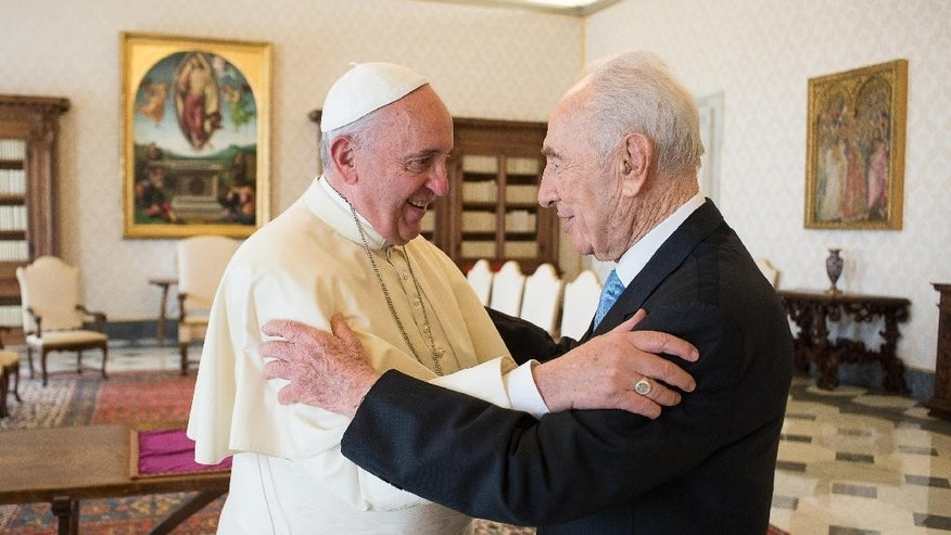 In this photo provided by the Vatican newspaper L'Osservatore Romano, Pope Francis meets with former Israeli President Shimon Peres on the occasion of their private meeting at the Vatican, Thursday, Sept. 4, 2014. Nobel Peace Prize laureate Peres ended his term as president of Israel on July 24, 2014, handing the presidency over to Reuven Rivlin. (AP Photo/L'Osservatore Romano, ho)