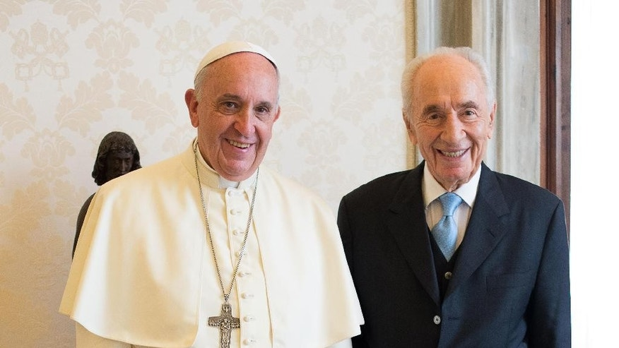 In this photo provided by the Vatican newspaper L'Osservatore Romano, Pope Francis meets with former Israeli President Shimon Peres, right, on the occasion of their private meeting at the Vatican, Thursday, Sept. 4, 2014. Nobel Peace Prize laureate Peres ended his term as president of Israel on July 24, 2014, handing the presidency over to Reuven Rivlin. (AP Photo/L'Osservatore Romano, ho)