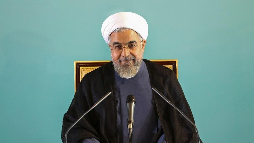 "Iranian President Hassan Rouhani gives a press conference in Tehran, Iran, Saturday, Aug. 30, 2014.  Rouhani called Western sanctions an ""invasion"" on Saturday after Washington imposed existing sanctions on more than 25 businesses, banks and individuals suspected of working to expand Iran's nuclear program, support terrorism and help Iran evade U.S. and international sanctions. Iran's state TV also said the move violated an interim agreement reached with world powers under which Western nations agreed to ease sanctions in exchange for Iran curbing its nuclear activities.  However, Friday's action did not constitute an expansion of the sanctions regime. (AP Photo/Ebrahim Noroozi)"