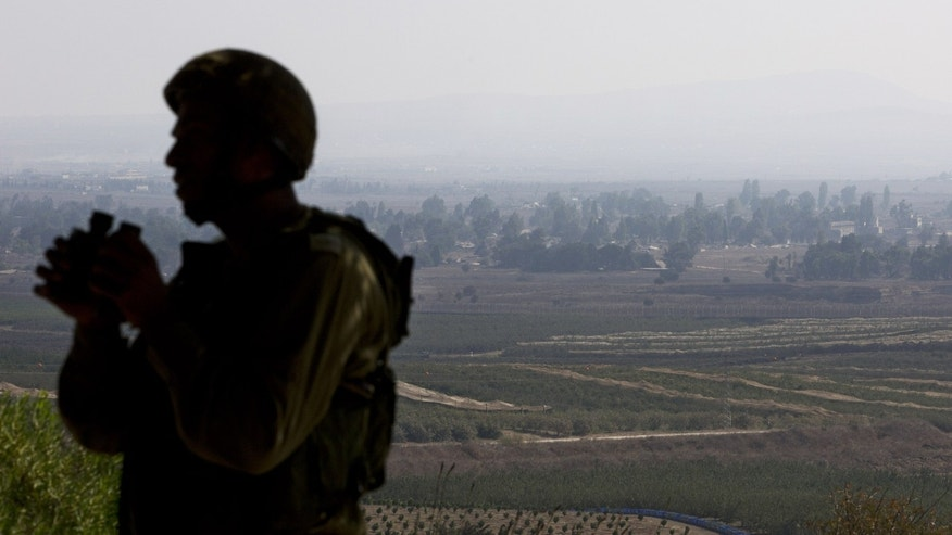 Sept. 1, 2014 - An Israeli soldier at an observation point on Mount Bental in the Israeli-controlled Golan Heights, overlooking the border with Syria, Monday.  Israel has said it will press for Hamas' disarmament in indirect talks in Cairo. A senior Hamas leader rejected Israel's demand that the group be disarmed as a condition for ending the long-running blockade of the Gaza Strip and permitting the opening of an air and seaport there.