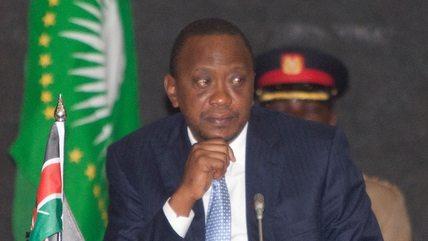 President of Kenya, Uhuru Kenyatta, listens during the AU Summit, Tuesday, Sept. 2, 2014, in Nairobi, Kenya.  A one-day African Union Peace and Security Summit  started in Nairobi, Kenya, Tuesday. (AP Photo/Sayyid Azim)