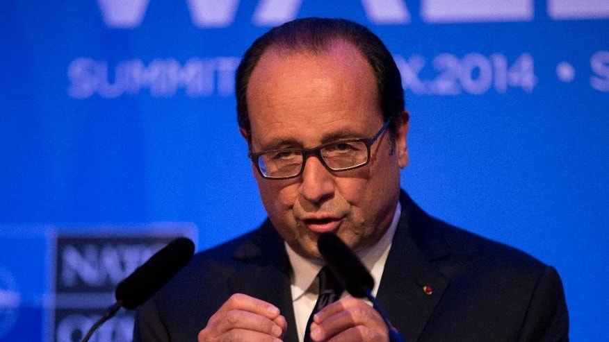 French President Francois Hollande gestures as he speaks during a press conference at the end of the NATO summit at the Celtic Manor Resort in Newport, Wales, Friday, Sept. 5, 2014.   (AP Photo/Matt Dunham)