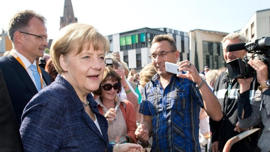 German Chancellor Angela Merkel arrives for an election campaign in Eberswalde, Germany, Saturday, Sept. 6, 2014. Merkel said in her weekly podcast Saturday that 75 years after Germany attacked Poland which led to World War II and the killing of six million Jews, it remains a top priority for the country to make Jews here feel safe. She expressed worries that there is not a single Jewish institution in the country without police protection. (AP Photo/dpa/Bernd von Jutrczenka)
