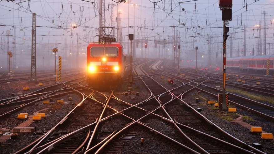 A train approaches to a train station as train drivers across Germany went on a three-hour warning strike to demand wage hike in Frankfurt, Germany, Saturday, Sept. 6, 2014. (AP Photo/Michael Probst)