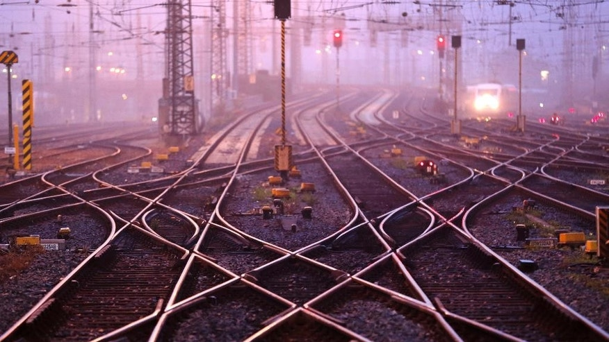 Rail tracks are empty with no trains running at a station as train drivers across Germany went on a three-hour warning strike to demand wage hike in Frankfurt, Germany, Saturday, Sept. 6, 2014. (AP Photo/Michael Probst)