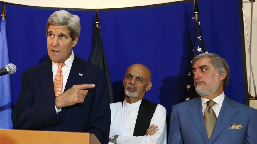 Aug. 8, 2014 - FILE photo of Secretary of State John Kerry, left, speaking as Afghan presidential candidates Ashraf Ghani Ahmadzai, center, and Abdullah Abdullah listen during a press conference in Kabul, Afghanistan. Abdullah said Monday he will not accept the expected outcome of the election's 2nd round and talks with Ahmadzai to form a national unity government are deadlocked.
