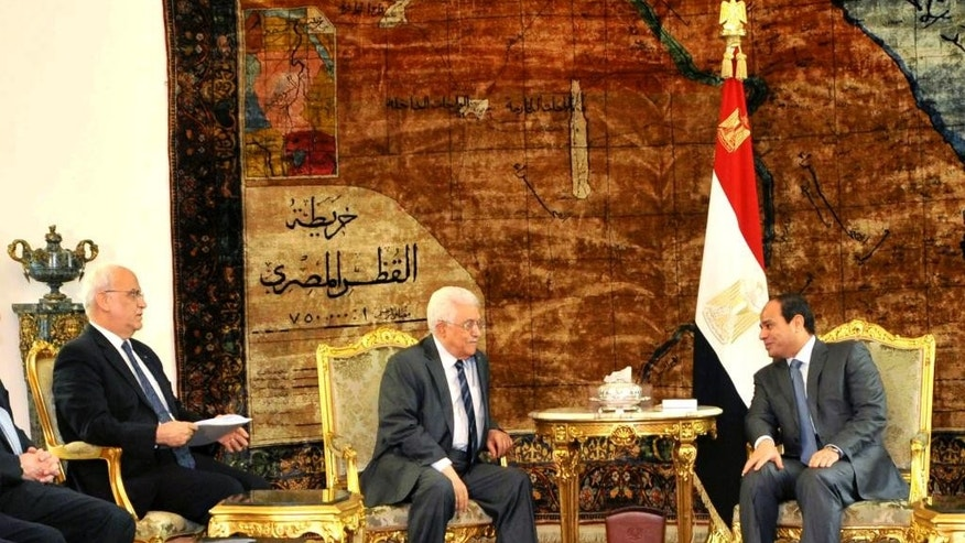 "In this photo provided by Egypt's state news agency MENA, Egyptian President Abdel Fattah el-Sissi, right, meets Palestinian President Mahmoud Abbas, center and Saeb Erekat, chief Palestinian negotiator Saeb Erekat, at the presidential palace in Cairo, Egypt, Sunday, Sept. 7, 2014. The Palestinian president threatened to dissolve a new unity government if the Hamas militant group does not give up power in the Gaza Strip. Abbas told reporters in Cairo late Saturday that he cannot accept the current situation in Gaza. He said if Hamas will not accept one central authority, ""we will not accept partnership with it.""(AP Photo/ MENA)"