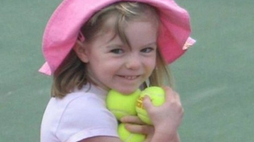 """This undated  file photo made available by the London Metropolitan Police shows missing British girl Madeleine McCann before she vanished from a Portuguese holiday complex on Thursday, May 3, 2007. The new book, """"Looking for Madeleine""""focuses on the investigation into the girl's disappearance."""
