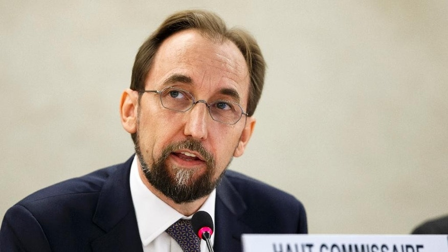 UN High Commissioner for Human Rights Prince Zeid al Hussein of Jordan adresses his first statement in his new role during the 27th session of the Human Rights Council, at the European headquarters of the United Nations in Geneva, Switzerland, Monday, Sept.  8, 2014. (AP Photo/Keystone, Salvatore Di Nolfi)