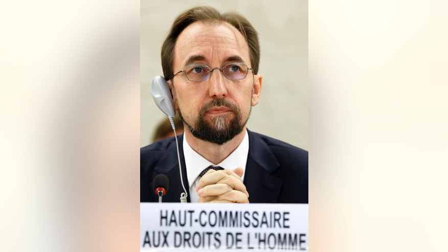 UN High Commissioner for Human Rights Prince Zeid al Hussein of Jordan listens to a speech during the 27th session of the Human Rights Council, at the European headquarters of the United Nations in Geneva, Switzerland, Monday, Sept.  8, 2014. (AP Photo/Keystone, Salvatore Di Nolfi)