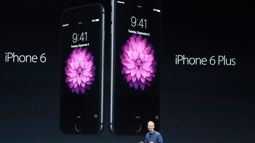 Apple CEO Tim Cook introduces the new iPhone 6 and iPhone 6 Plus on Tuesday, Sept. 9, 2014, in Cupertino, Calif.