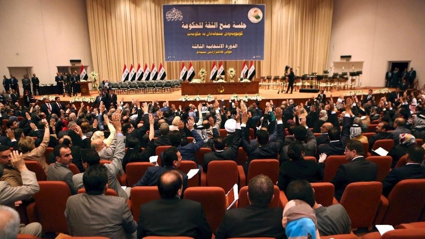 Iraqi lawmakers attend the session to approve the new government in Baghdad, Iraq, Monday, Sept. 8, 2014.  Iraq's parliament officially named Haider al-Abadi the country's new prime minister late Monday and approved most of his proposed Cabinet amid calls by the Arab League for its members to combat the Sunni militant group violently advancing across Iraq and Syria. (AP Photo/Hadi Mizban, Pool)