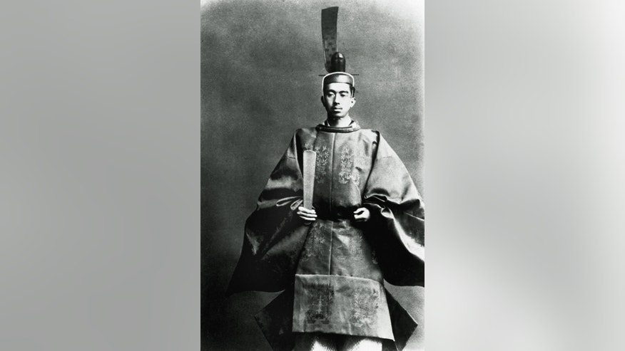 FILE - In this 1928 file photo, Emperor Hirohito poses in the imperial robes that he wore when he succeeded his father to Japan's throne in Kyoto, western Japan. Japan's longest-serving emperor has received one of the longest-ever official histories, but despite being 24 years in the making and 12,000 pages long, scholars and journalists say the annals of Emperor Hirohito are still incomplete. In a tradition that dates back 14 centuries, the Imperial Household Agency released a 61-volume history on Tuesday, Sept. 9, 2014 that includes childhood letters to his parents while stepping gingerly around what many really want to know: Hirohito's thinking on issues such as his responsibility for World War II and the Yasukuni shrine for the war dead.  (AP Photo/File)