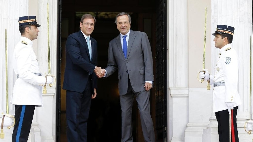 Greek Prime Minister Antonis Samaras, left, poses with his Portuguese counterpart Pedro Passos Coelho for photographers at the Maximos Mansion in Athens on Tuesday, Sept. 9, 2014. Coelho is expected to discuss post-bailout growth strategies with Greek officials. (AP Photo/Thanassis Stavrakis)