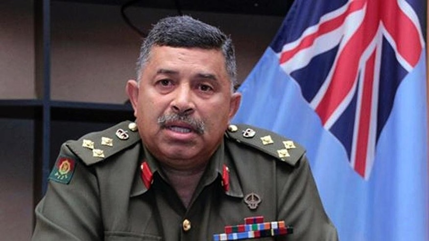 FILE - In this Sept. 2, 2014 file photo provided by Fiji's Ministry of Information, Fiji's military commander Brig. Gen. Mosese Tikoitoga speaks about the capture of 45 Fiji troops in Syria during a press conference at the military headquarters in Suva. Fiji said Thursday, Sept. 11, 2014 that its 45 United Nations peacekeepers being held captive in Syria are shown in a video posted on YouTube. The 15-minute video shows two men speaking in Arabic with the Fijian troops sitting cross-legged in the background. (AP Photo/Fiji's Ministry of Information) EDITORIAL USE ONLY