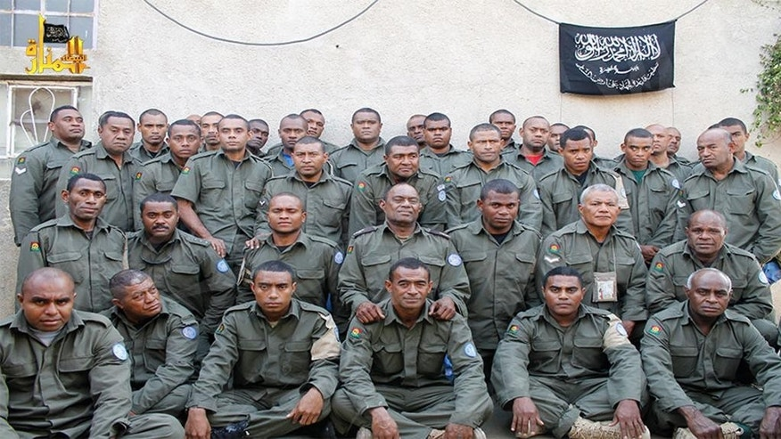 FILE - This undated file image attached in a statement released on Saturday, Aug. 30, 2014 on the Hanin Network website, a militant website, shows Fijian UN peacekeepers who were seized by The Nusra Front on Thursday, Aug. 28, 2014,  in the Golan Heights in the buffer zone between Syria and Israel. Fiji confirmed Thursday that soldiers shown in a new video posted online are its 45 United Nations peacekeepers being held captive in Syria. (AP Photo/Hanin Network Website, File)