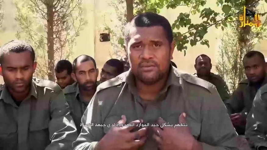 "This image made from video posted on a militant social media account on Thursday, Sept. 11, 2014 shows U.N. peacekeepers from Fiji held captive by militants from the Nusra Front in Syria. Al-Qaida-linked Syrian rebels on Thursday released all 45 Fijian peacekeepers they had held captive for two weeks, the United Nations said, bringing an end to a crisis that had pulled the U.N. monitoring force into the chaos of Syria's civil war. Arabic reads, ""we truly understand the limited resources that Nusra Front have."" (AP Photo via militant social media account)"