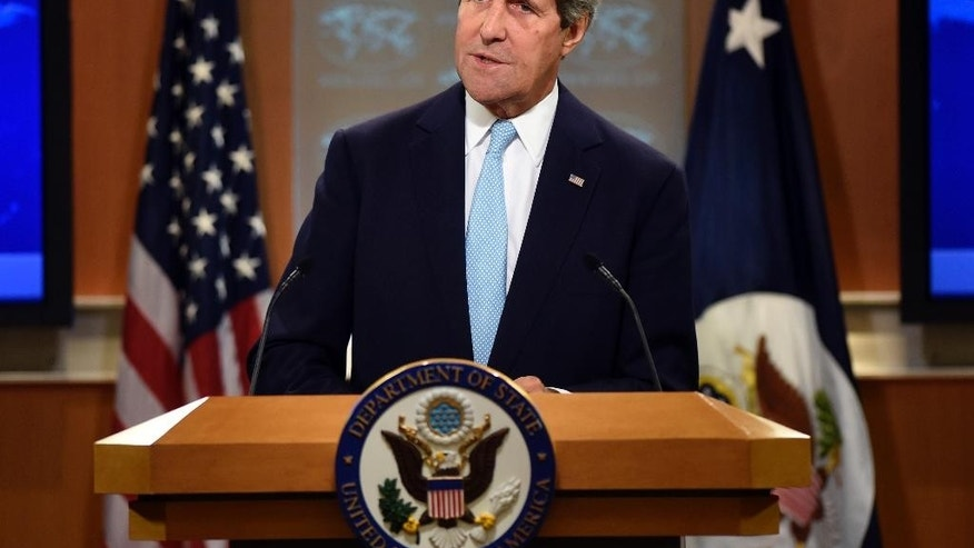 FILE - In this Monday, Sept. 8, 2014, file photo, Secretary of State John Kerry speaks at State Department in Washington. Kerry is to travel to the Middle East this week, with stops in Saudi Arabia and Jordan, to try to line up support for a coalition to take on the extremist Islamic State group. (AP Photo/Susan Walsh, File)