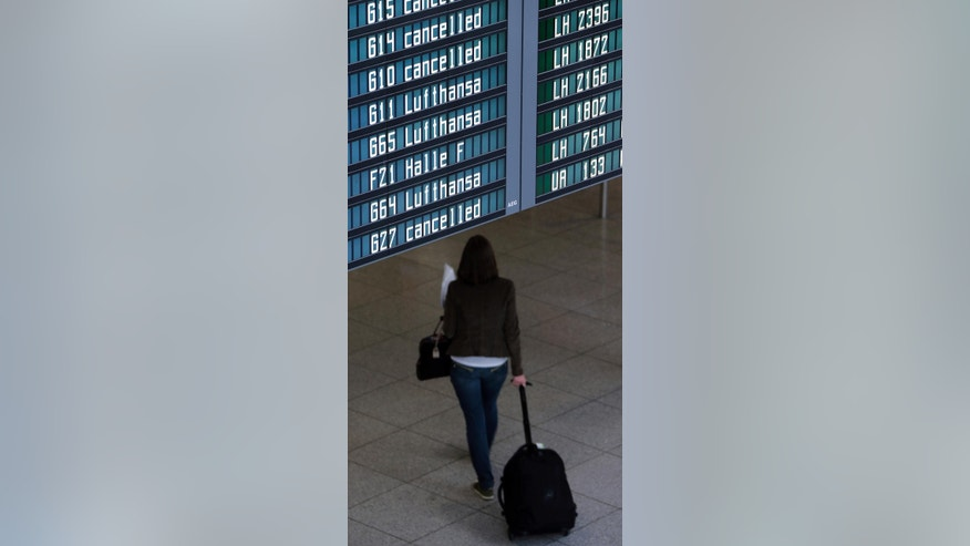 Cancelled flights are displayed on the flight board at an airport terminal before pilots of Lufthansa go on an eight-hour warning strike at Munich Airport in Munich, southern Germany, Wednesday, Sept. 10, 2014. (AP Photo/Matthias Schrader)