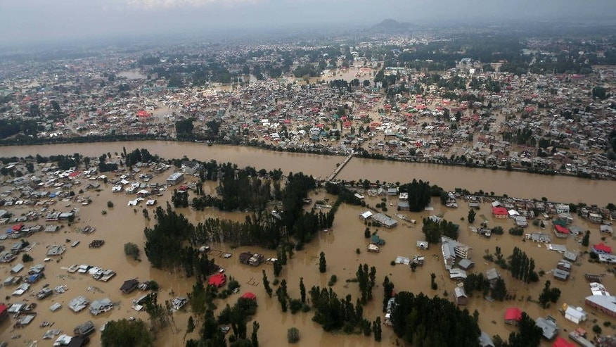 An aerial view shows buildings submerged in floodwaters in Srinagar, in Indian Kashmir, Tuesday, Sept. 9, 2014. The death toll from floods in Pakistan and India reached 400 on Tuesday and have put more than half a million people in peril and rendered thousands homeless in the two neighboring states. (AP Photo/Dar Yasin)