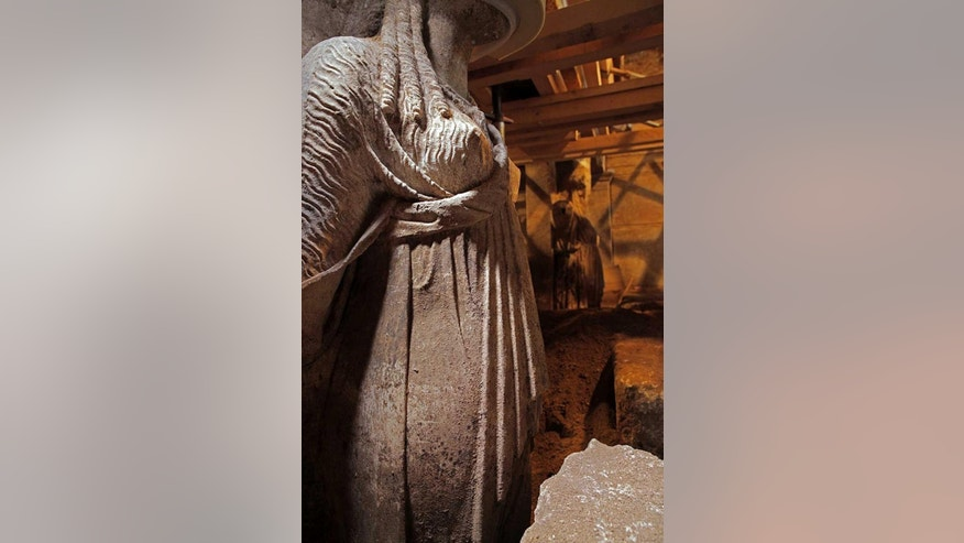 This photo released on Thursday, Sept. 11, 2014 by the Greek Culture Ministry shows two approximately life-sized female statues on a wall leading to a yet unexplored inner room of a huge underground ancient tomb, in Amphipolis, northern Greece. The tomb dates between 325 B.C. — two years before the death of ancient Greek warrior-king Alexander the Great — and 300 B.C. Archaeologists have also discovered two large marble sphinxes on the facade of the barrel-vaulted tomb, which was originally topped by a marble lion on a high plinth. It is not yet  known who the tomb was built for, although Alexander himself was buried in Egypt. (AP Photo/Culture Ministry)
